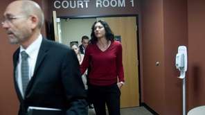Soccer star Hope Solo leaves a courtroom with