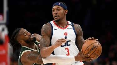 Bucks guard Wesley Matthews, left, reaches for the
