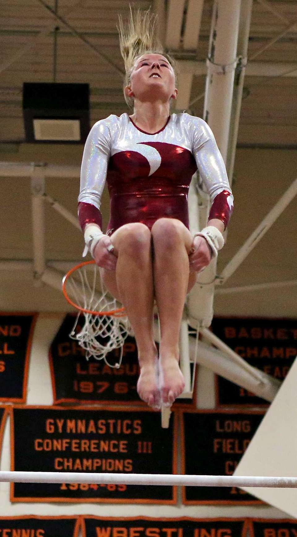 Bay Shore's Olivia O'Connor dismounts from the uneven
