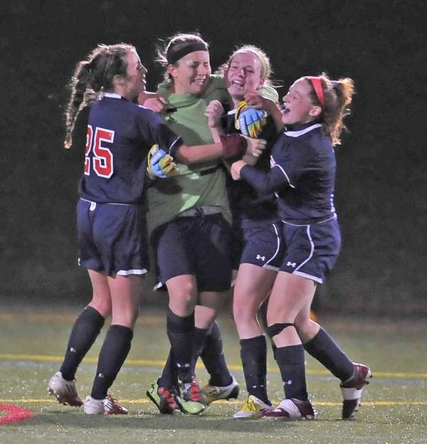 Cold Spring Harbor goalkeeper Stephanie Mahder is hugged