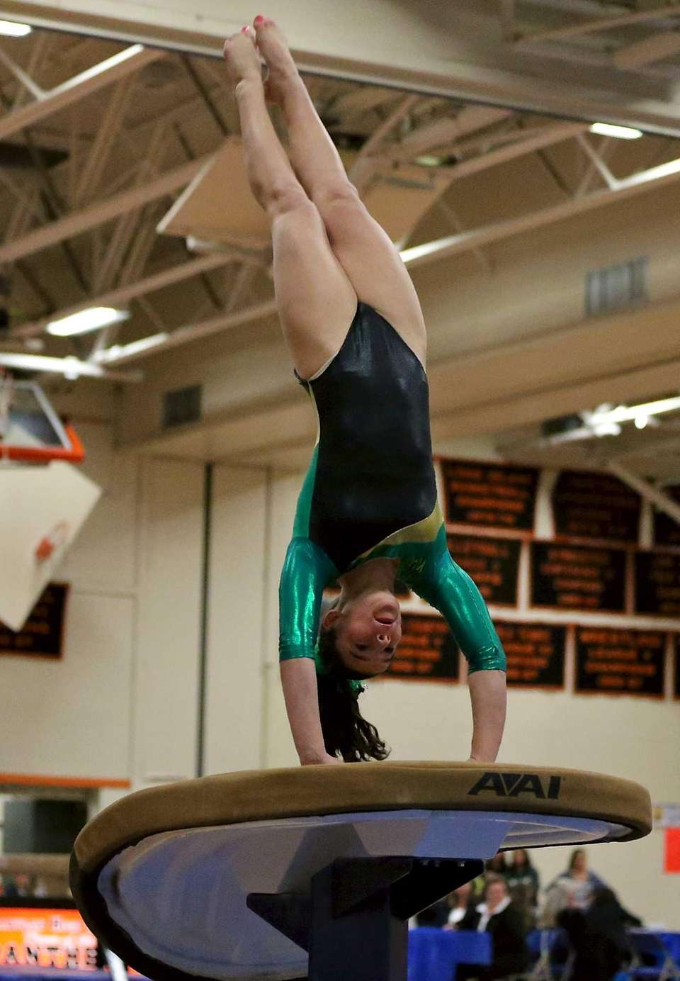 Ward Melville's Cydney Crasa springs off the vault.
