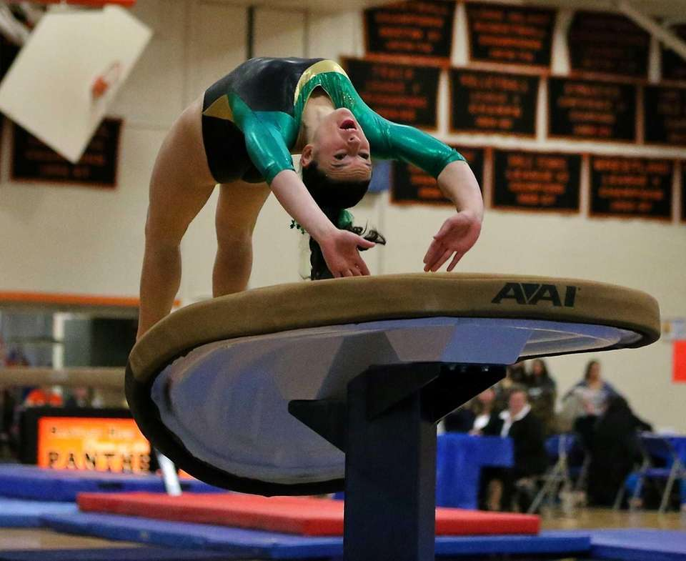 Ward Melville's Cydney Crasa leaps onto the vault