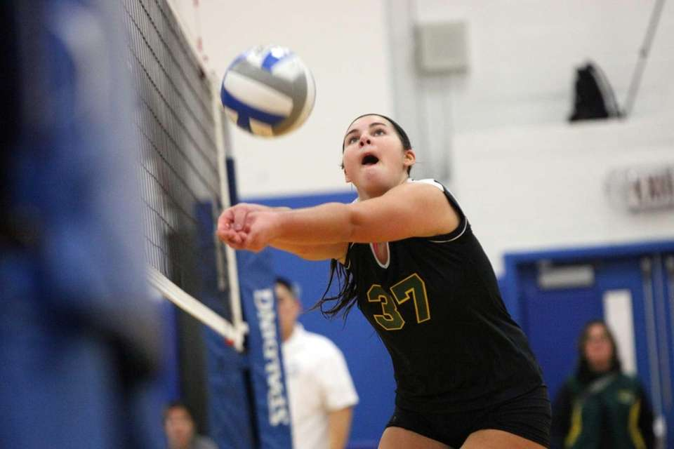 Ward Melville's Kellie Rizzo bumps a ball against