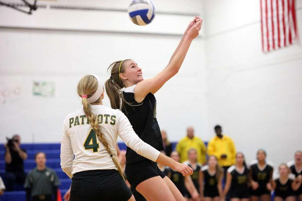 Ward Melville's Kristin Bendy bumps the ball over