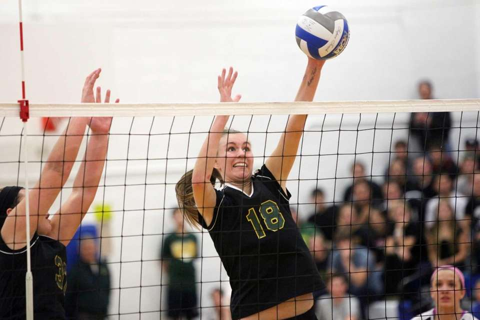 Ward Melville's Kristin Bendy blocks a spiked ball