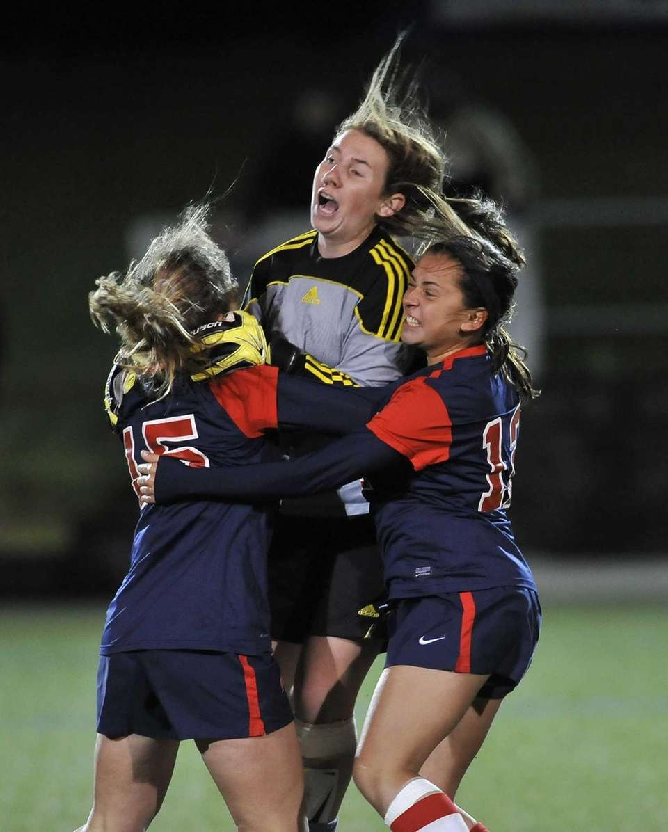 South Side goalkeeper Sarah McCarthy jumps into the