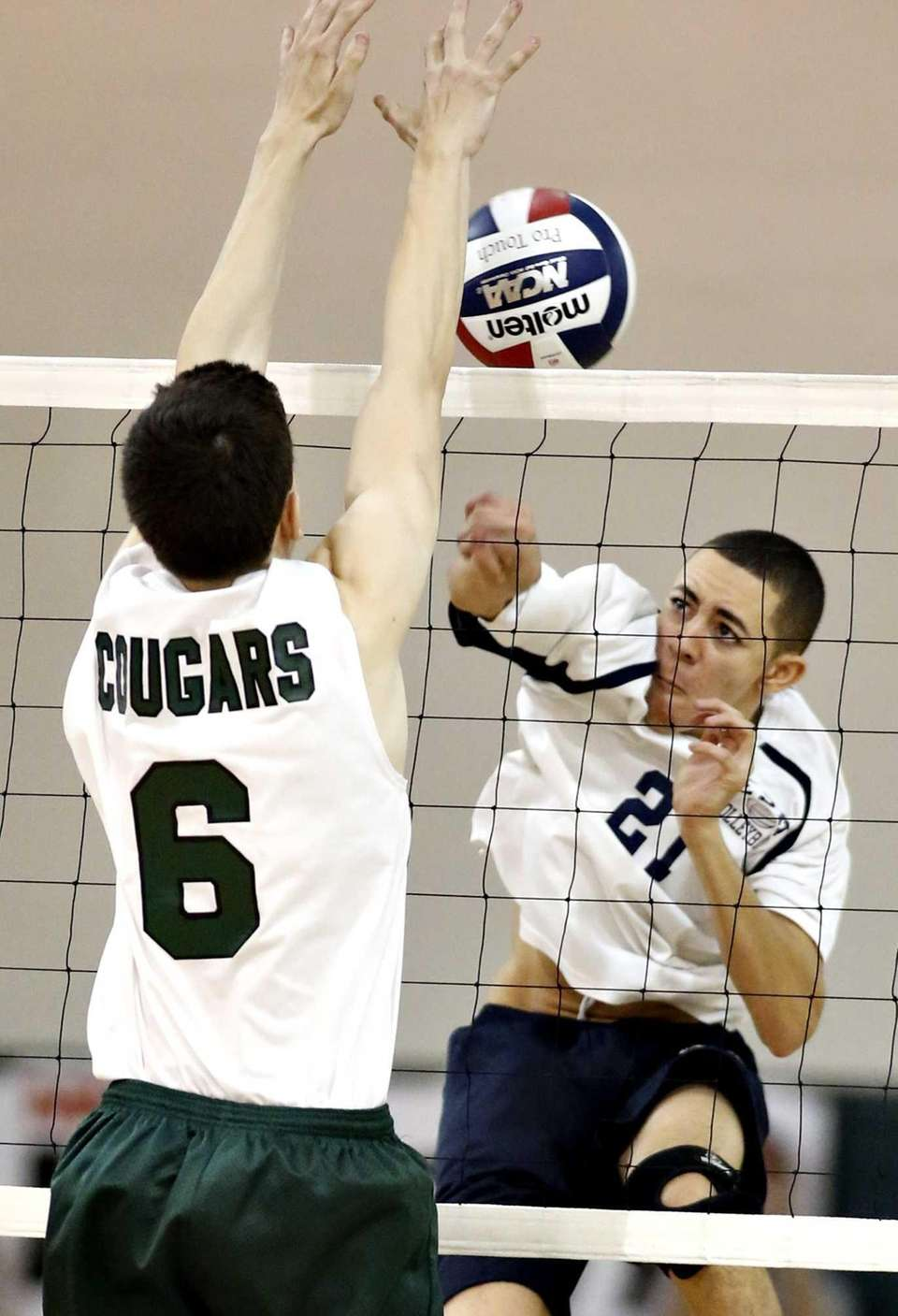 Bellmore's Ron Gutman (6) blocks the spike by
