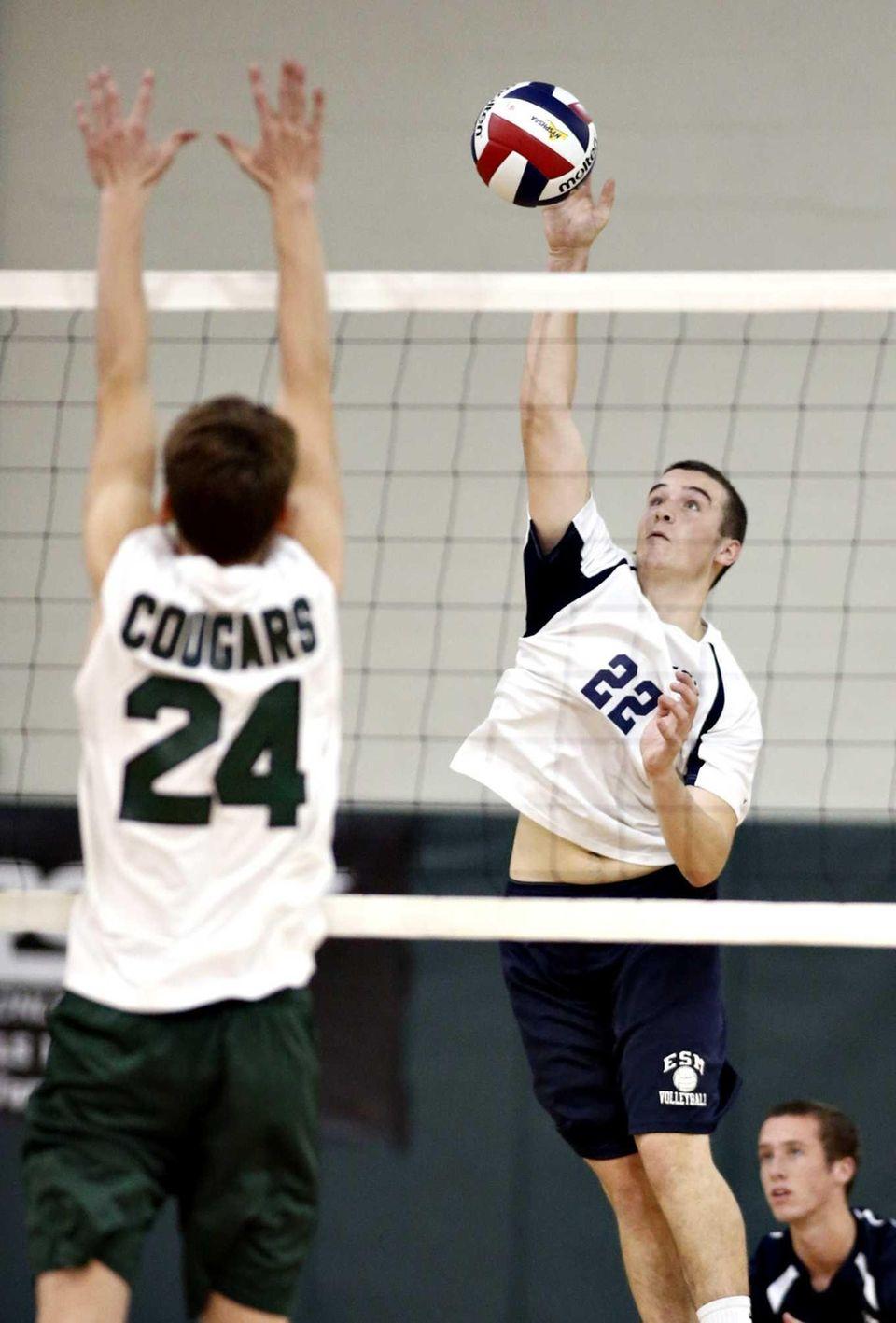 ESM's Brandon Calderone (22) tips the ball over