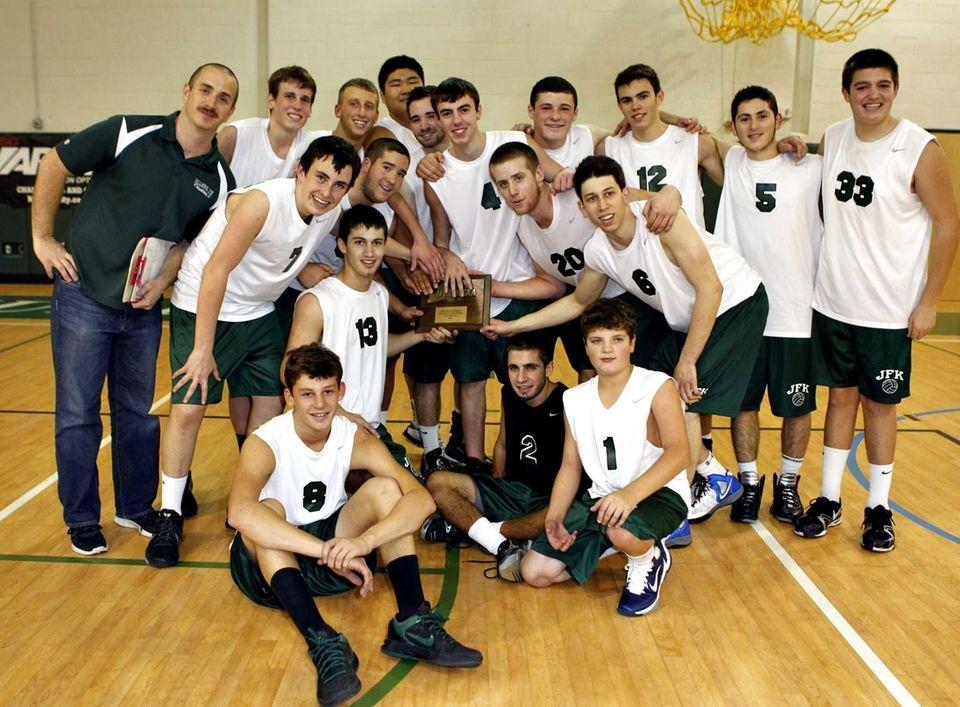 Bellmore JFK boys volleyball team poses after winning