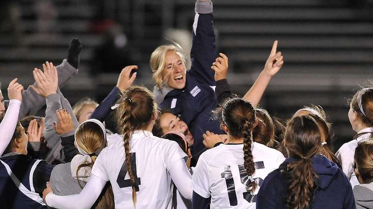 Northport players celebrate their victory by hoisting up