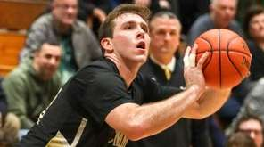 Commack's Spencer Malloy #32 sets to shoot from
