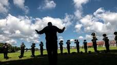Members of the Brentwood marching band practice under