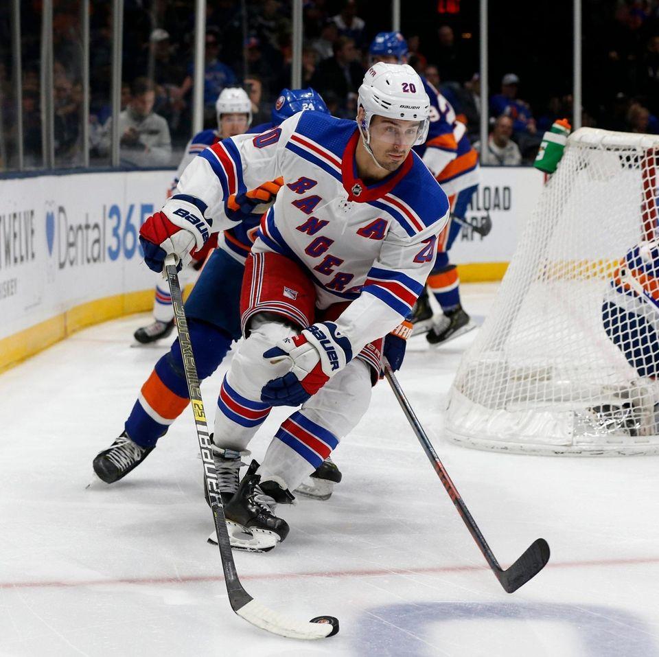 The Rangers' Chris Kreider skates with the puck
