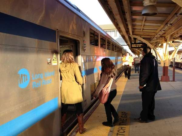Commuters board the 7:48 a.m. LIRR train in
