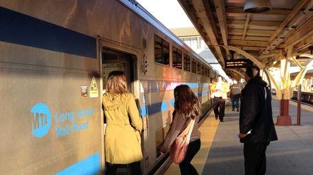 Commuters board the 7:48 a.m. LIRR train in