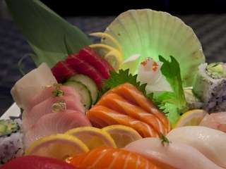 "A ""Sushi Sashimi Dinner Platter"" is served at"