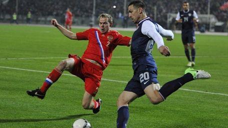 Russia's Aleksandr Anyukov, left, vies with USA's Geoff