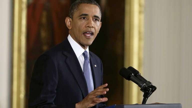 President Barack Obama makes an opening statement during