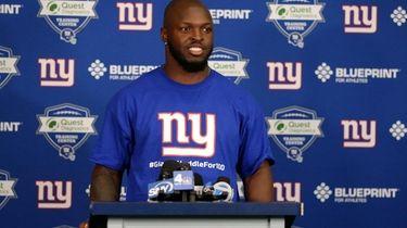 Giants linebacker Alec Ogletree speaks to the media