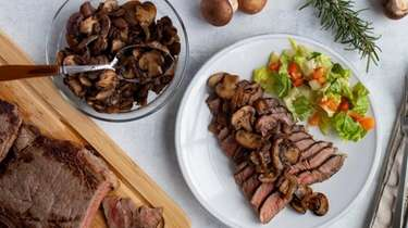Sirloin steak with sautéed mushrooms and onions.