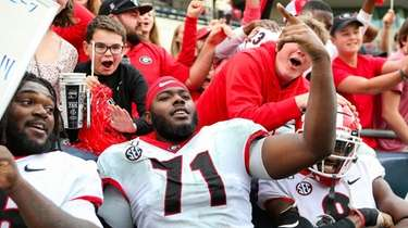 Andrew Thomas celebrates following Georgia's win over Georgia