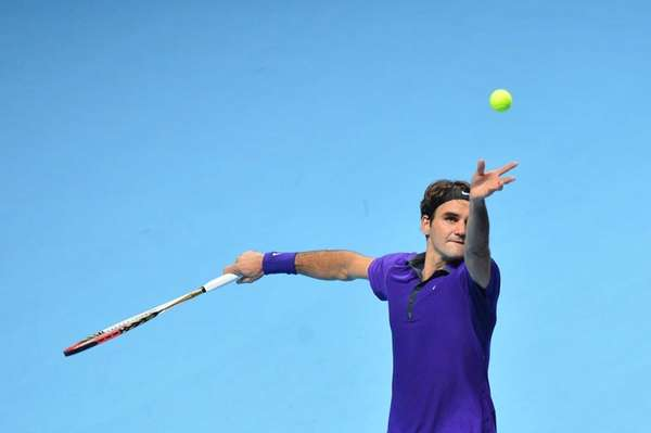Switzerland's Roger Federer serves against Serbia's Novak Djokovic