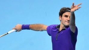 Switzerland's Roger Federer serves against Serbia's Novak Djokovic