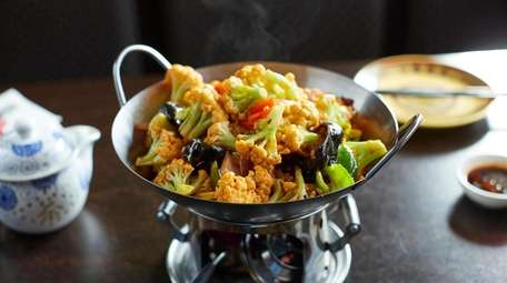 Spicy dry stir-fried cauliflower uses a delicate variety