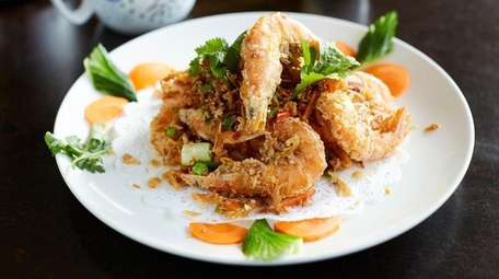 Salt and pepper shrimp are fried, heads, tails,