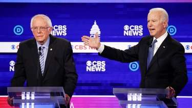 Democratic presidential candidates, Sen. Bernie Sanders, I-Vt., left,