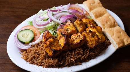 The chicken tikka kebab features marinated cubes of