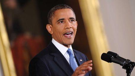 President Barack Obama speaks during his first press