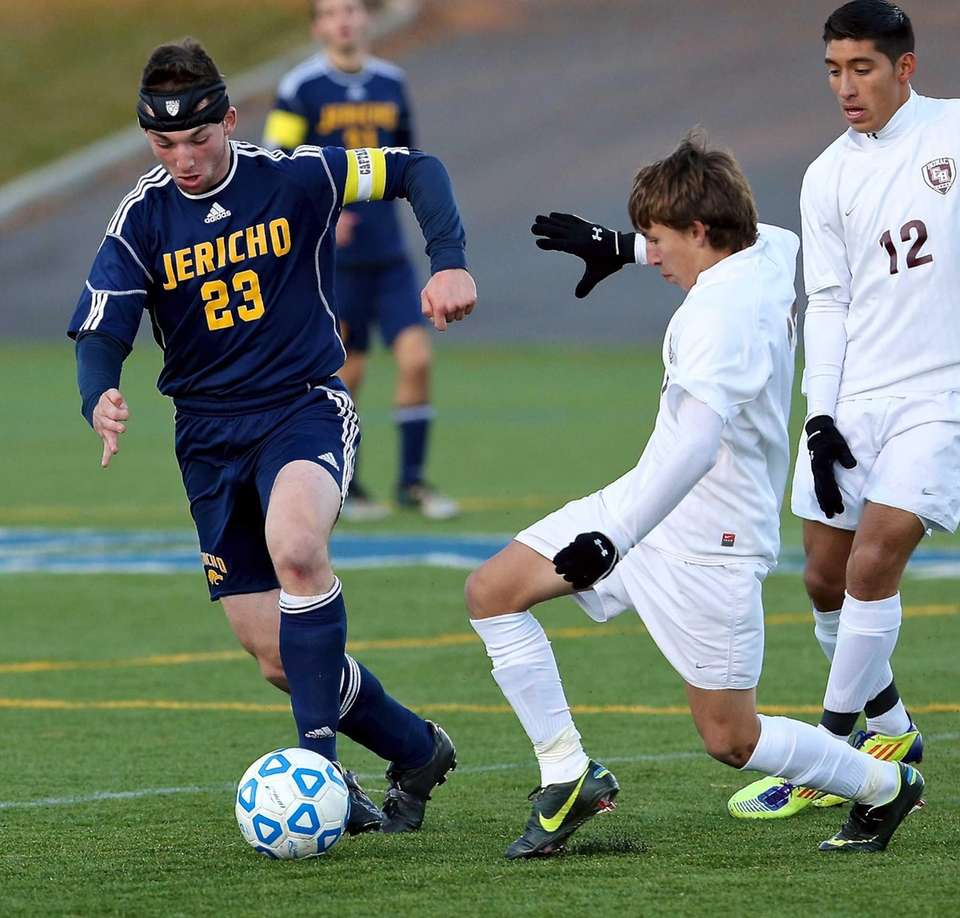 Jericho's Harrison Rieber dribbles past East Hampton's Esteban