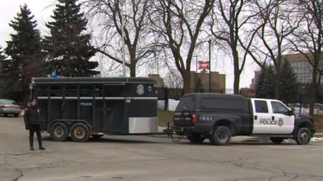 This image provided by WISN-TV, police respond to