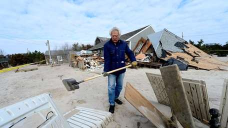 Peter Incorvaia begins to clean up his beachfront