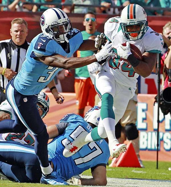 Miami Dolphins' Marcus Thigpen returns a second-quarter kick