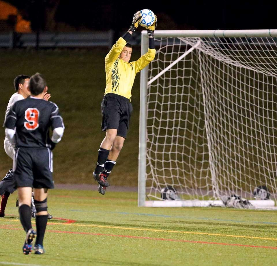 Syosset keeper Aprilakis Konstantinos makes the save on