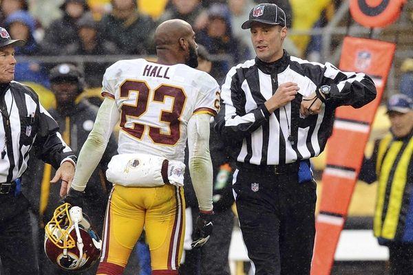 Washington Redskins cornerback DeAngelo Hall confronts head linesman