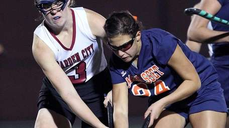 Garden City's Linda Attanasio competes for the ball