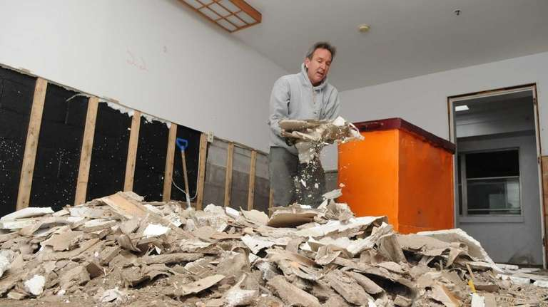 Scott Lockwood cleans out debris from one of