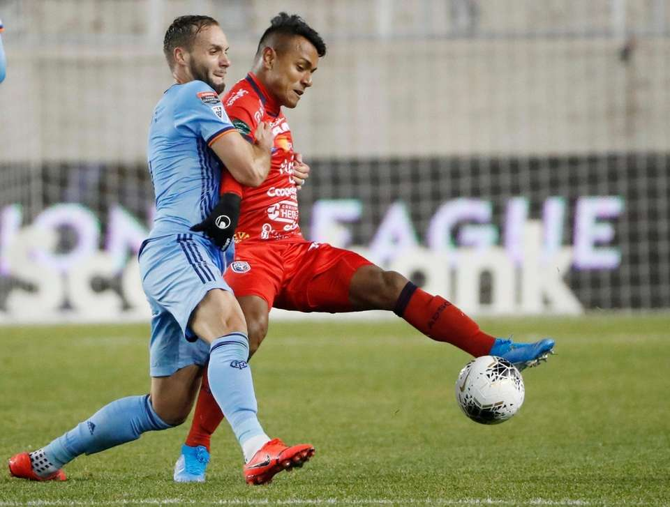 New York City FC defender Maxime Chanot holds