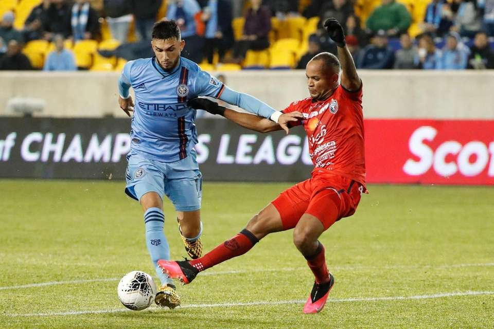 New York City FC midfielder Valentin Castellanos fends