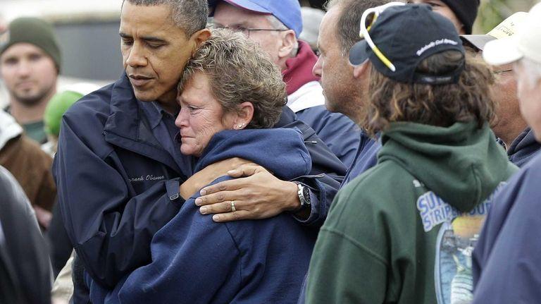 President Barack Obama embraces Donna Vanzant during a