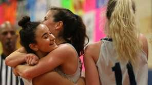 Our lady of Mercy's Samantha Shea (12) hugs