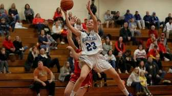 Our lady of Mercy's Isabella Coles (23) drives