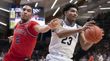 Jermaine Samuels of the Villanova Wildcats controls the