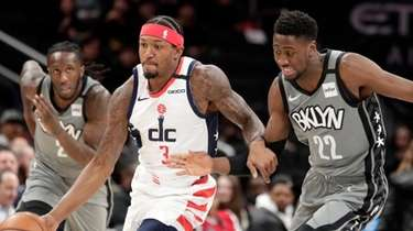 The Wizards' Bradley Beal moves the ball as