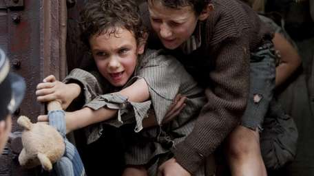 Children cry as they were being held in