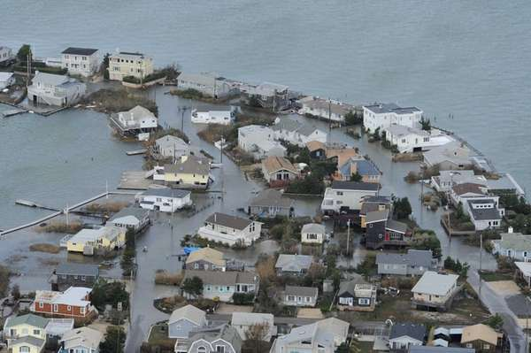 Homes in Westhampton have flooded lawns from the