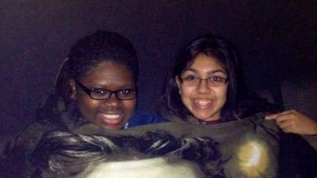 Adrienne Cantave, left, and Victoria Rosa, both 15